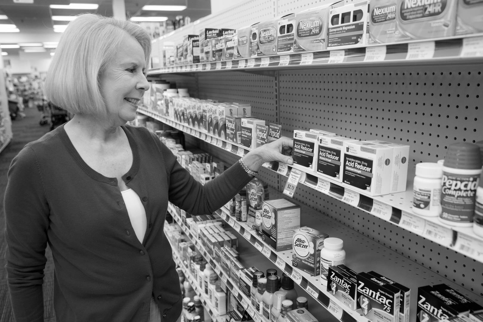 A patient looks at Good Neighbor Pharmacy brand over the counter products on the shelf