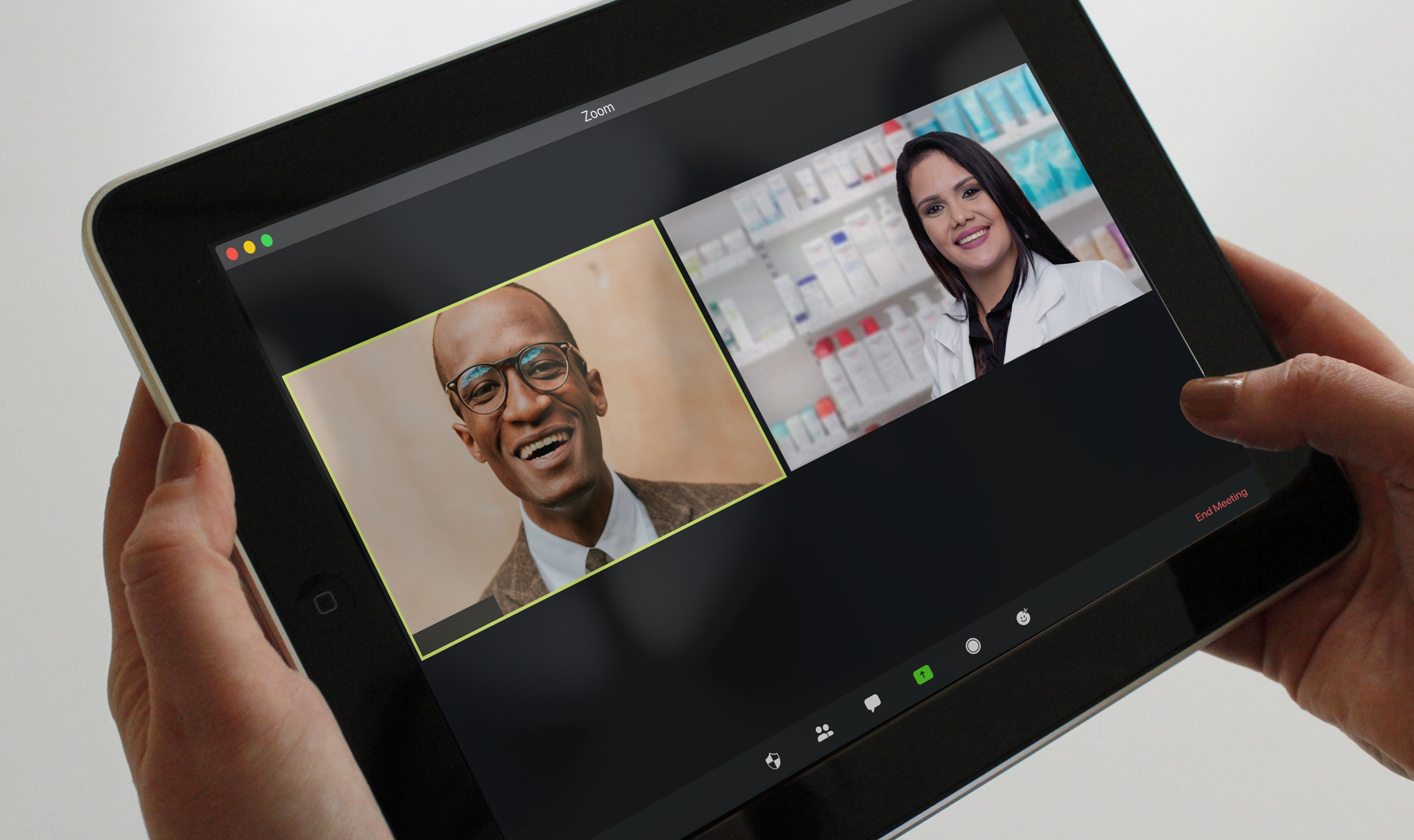 A pharmacist hosts a virtual meeting with an elected official on her tablet
