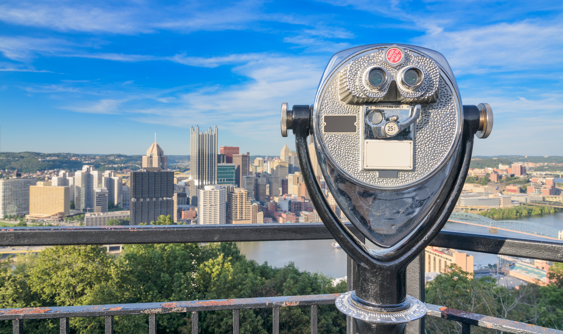 Rooftop binoculars looking out over a city