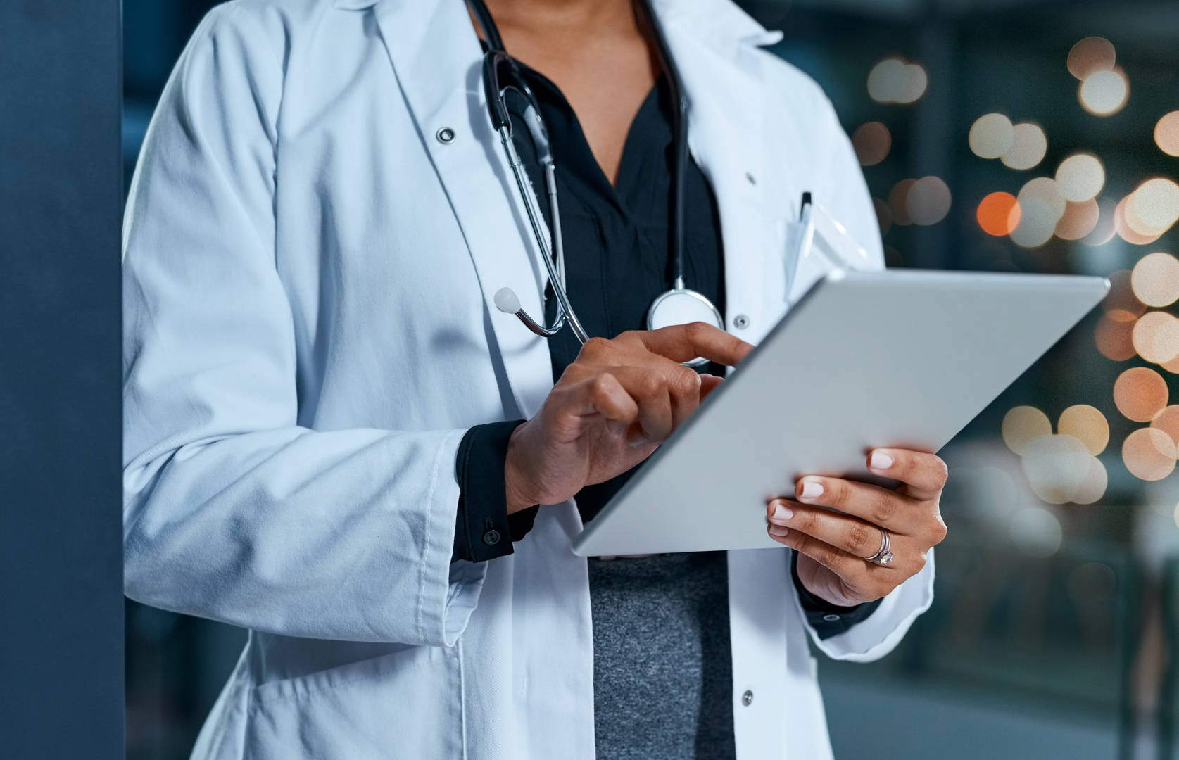 Doctor looking at iPad